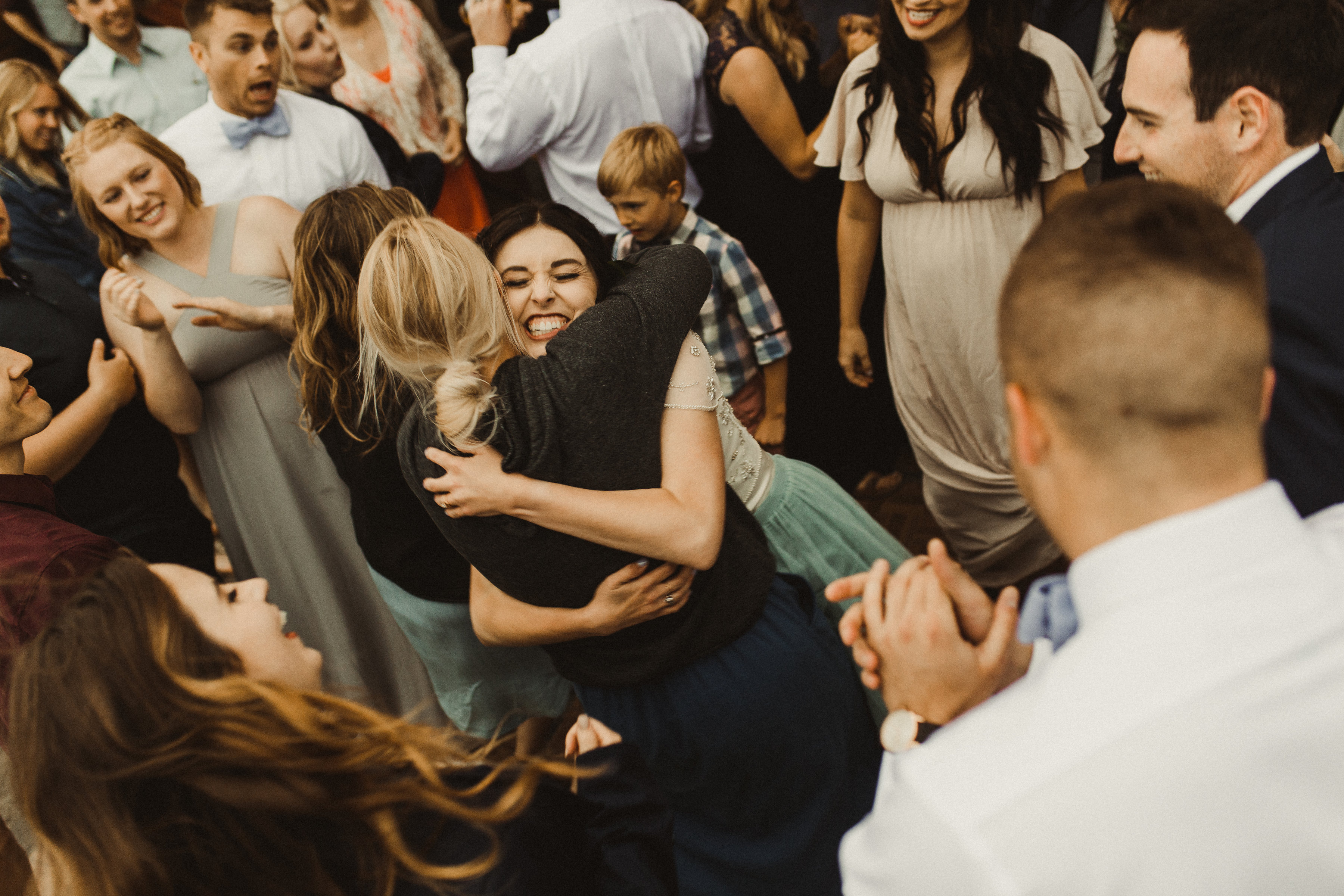 Bride hugs her best friends and guests on her long awaited wedding day