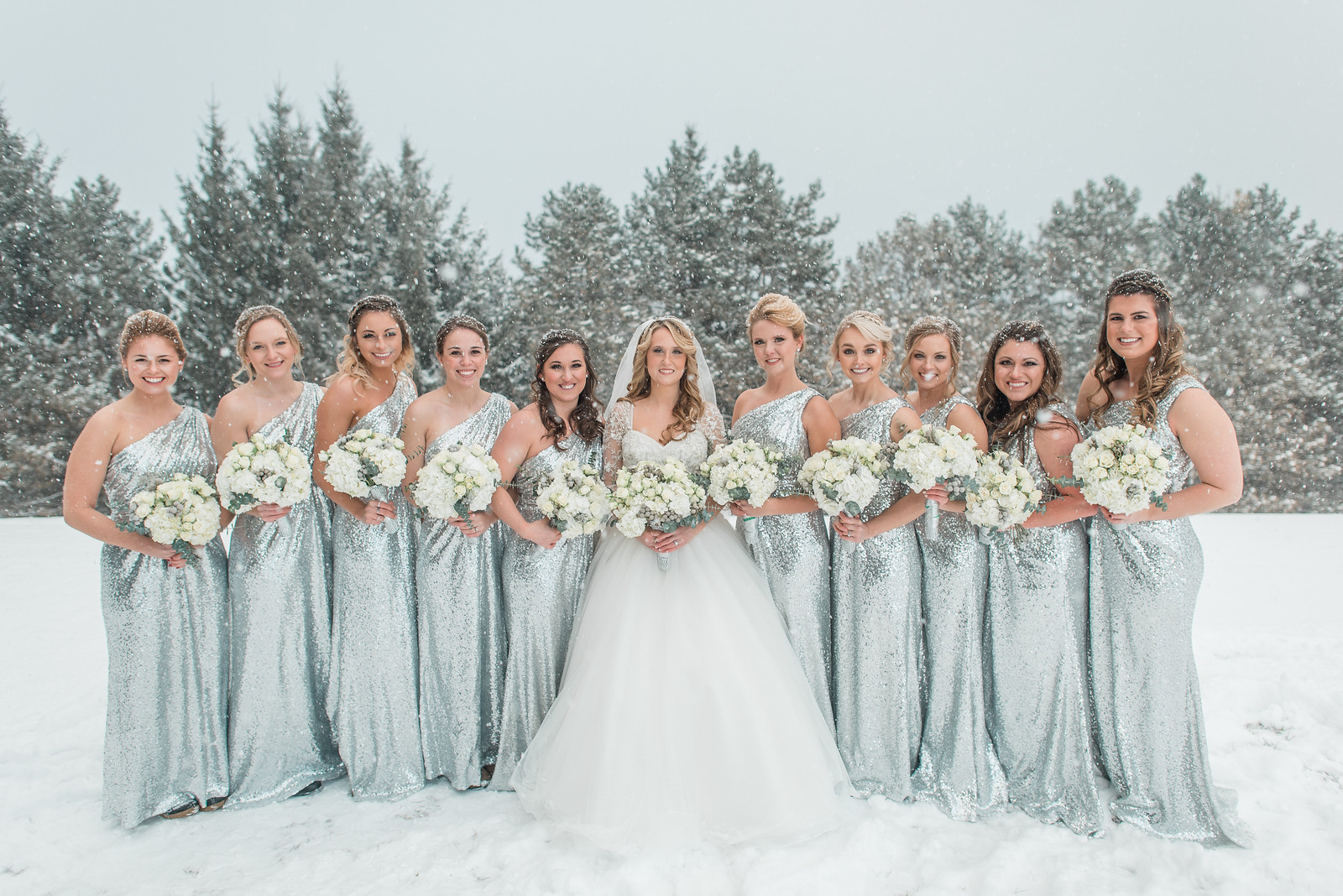 snowly silver sequin bridesmaid dress with one shoulder and rouching.