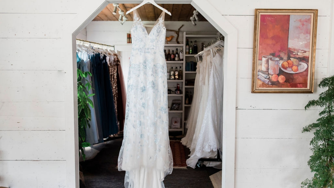 Luna bridal gown blue wedding dress revelry bridal at try-on party in austin texas hanging in doorframe
