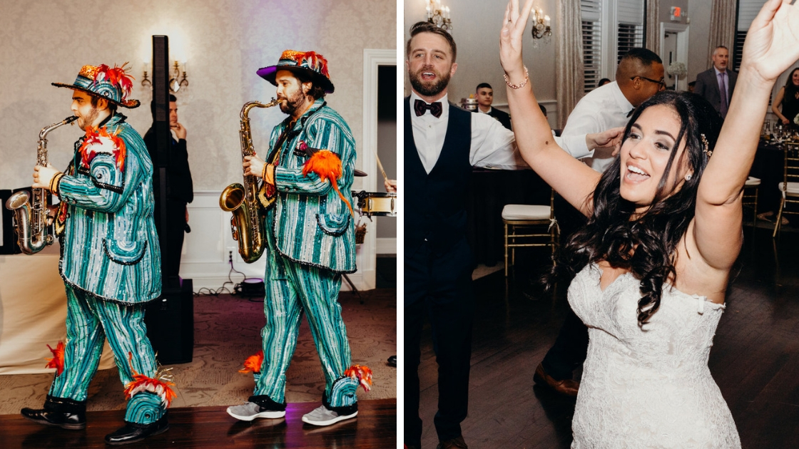 Marching band entering wedding reception with saxaphones bride throwing hands up and dancing in fitted lace bridal gown on wedding day reception