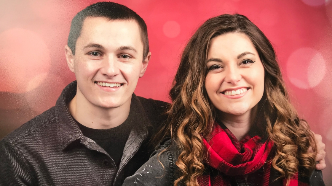 Megan and fiance smiling for formal photos high school sweethearts