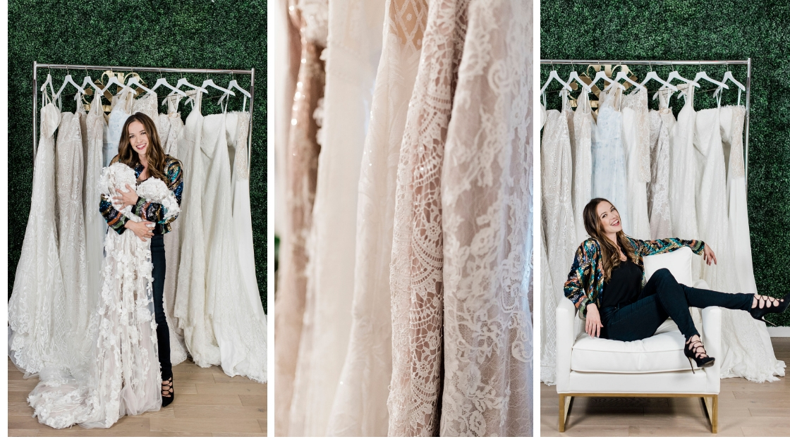 Michelle founder of revelry smile and pose in front of rack of wedding dresses lace details sparkles floral patters