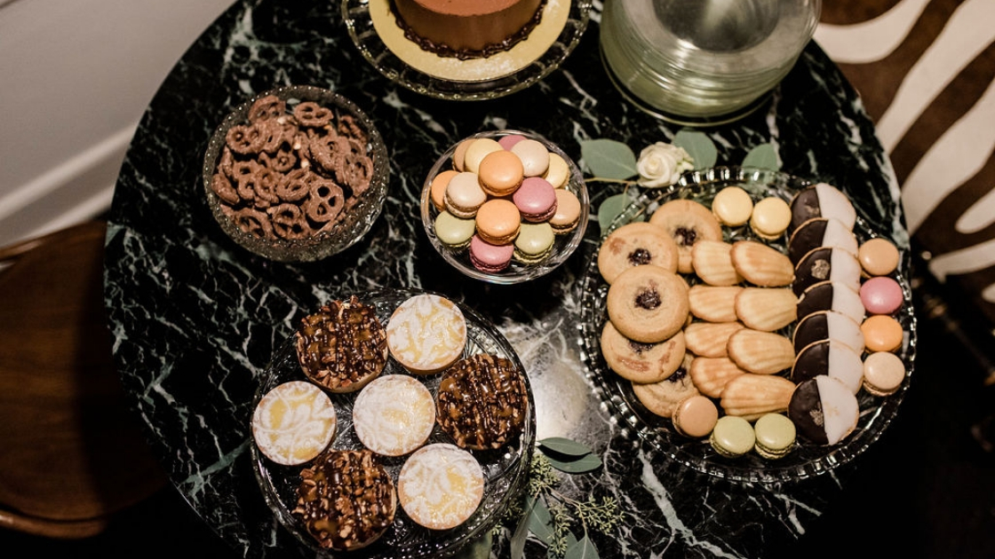 cookies dips macaroons pretzels and other tasty treats perfect for a winter try on party for a wedding