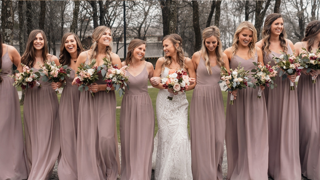 Michelle wedding day in decklyn bridal gown with bridesmaids in pink mauve dresses love friendship walking