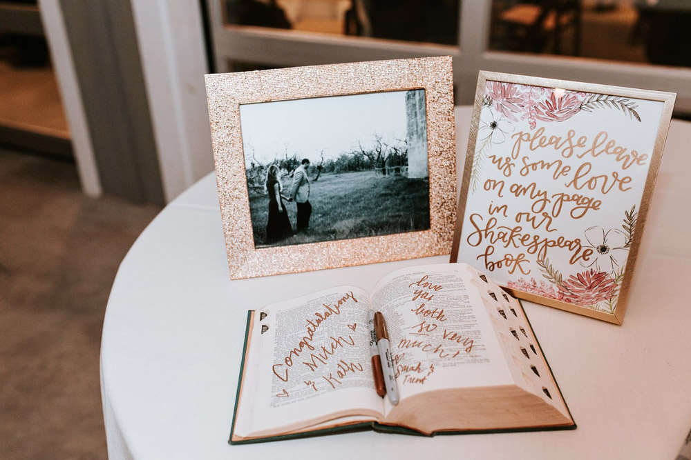 personalized notes from guests on pages of their Shakespeare book. along with a framed photo of the couple.