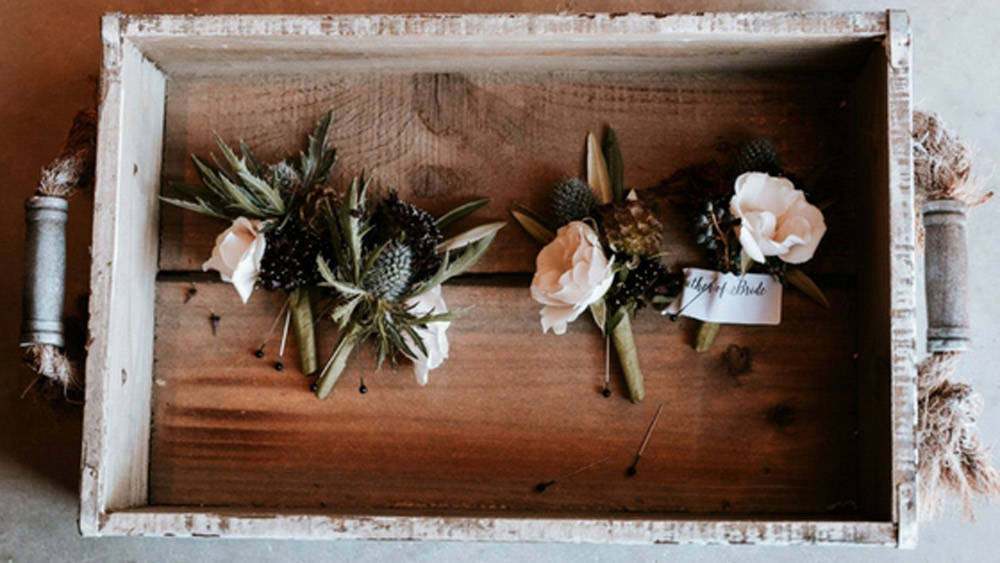 groomsmen boutonnieres inside tray.