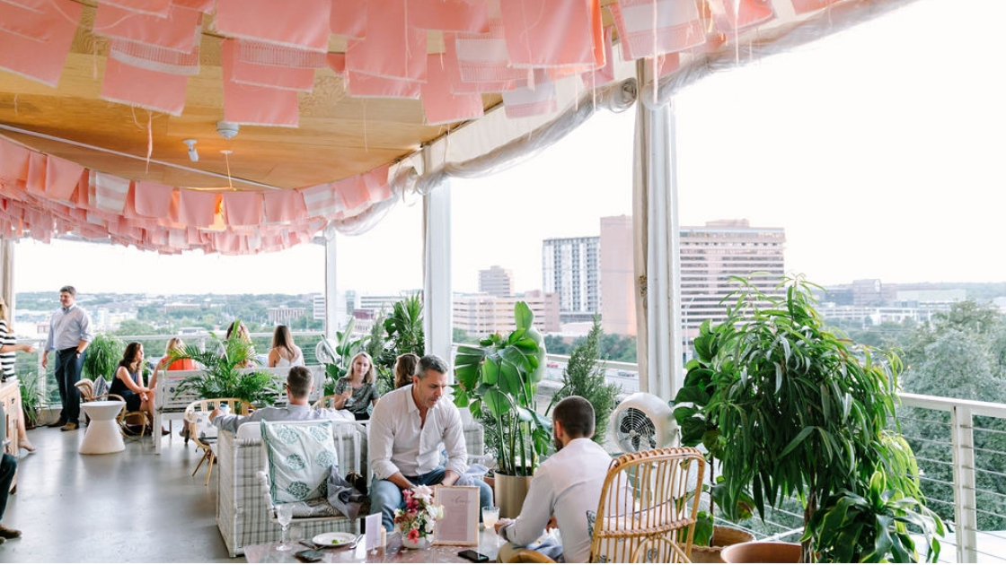 P6 rooftop austin venue pink flags buildings in downtown austin texas greenery views