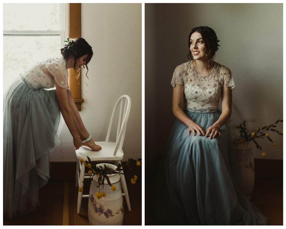 Bride in blue dress puts on garter and poses for pictures before her wedding