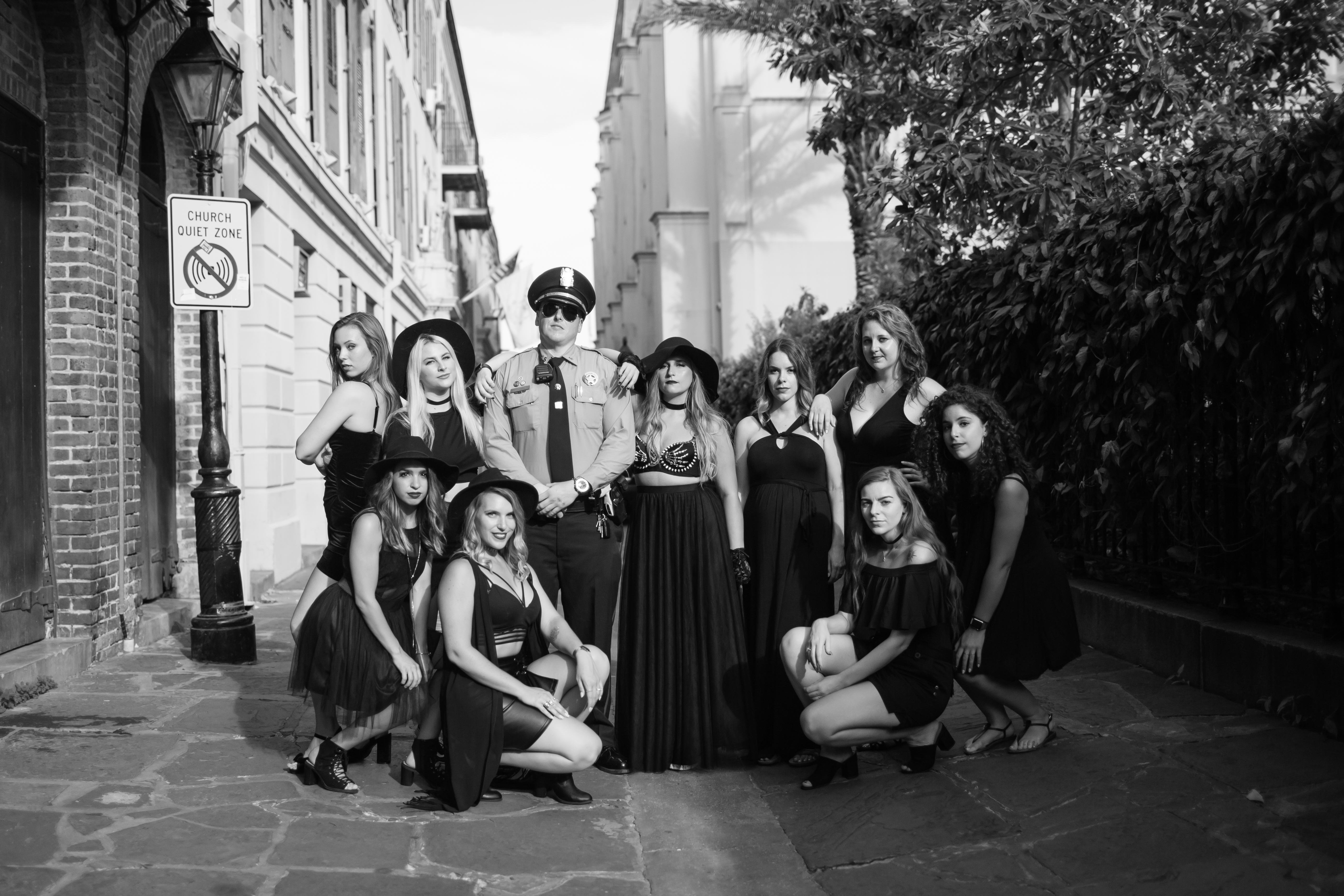 Police Officer gets in the moody poses with alley shots. Looks like these all black beauties cast a spell on everyone they met this bachelorette weekend.