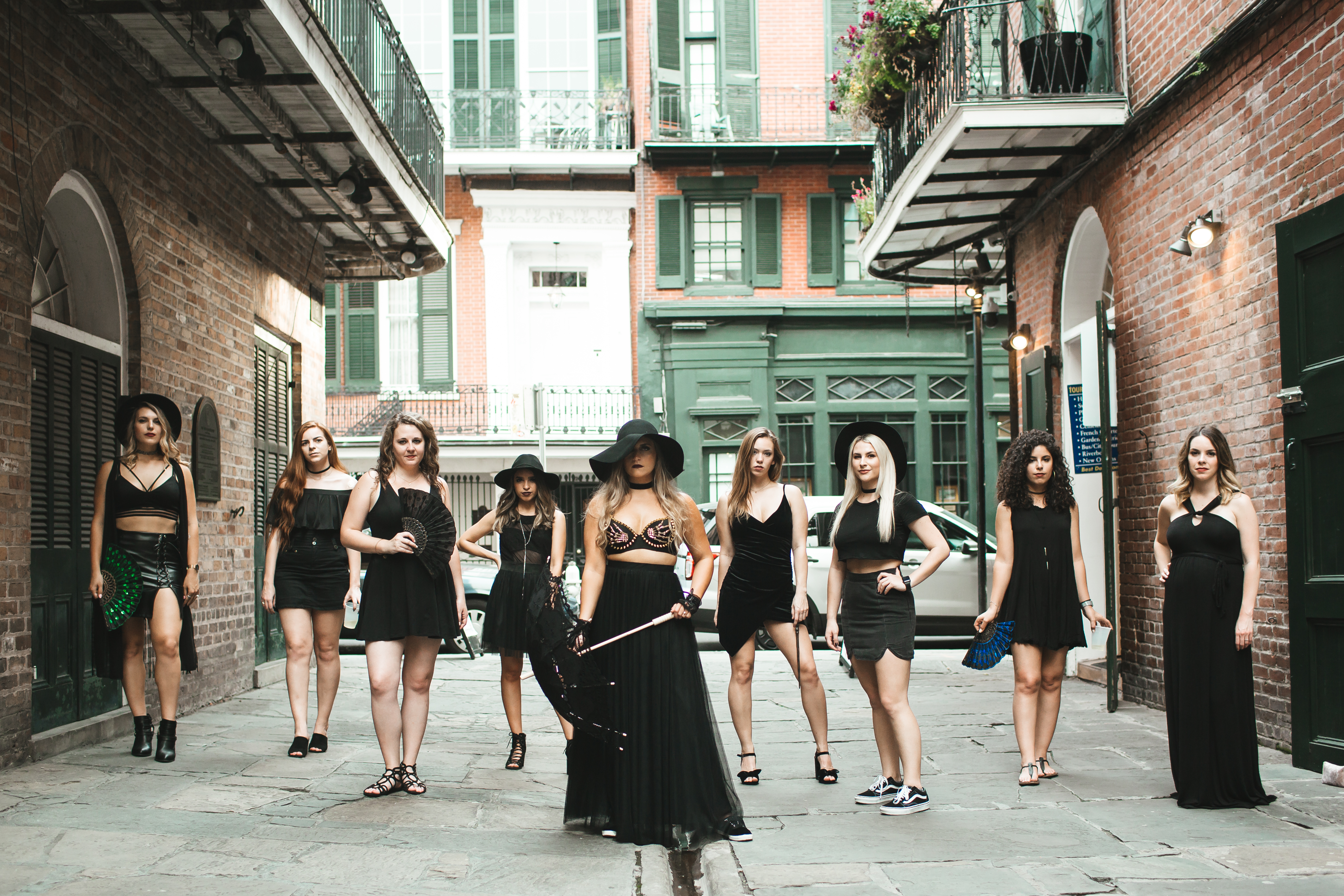 Rachel from Revelry in Skylar black skirt and witchy vibez from her supporting bridesmaids in all black for this Nola bachelorette photoshoot!