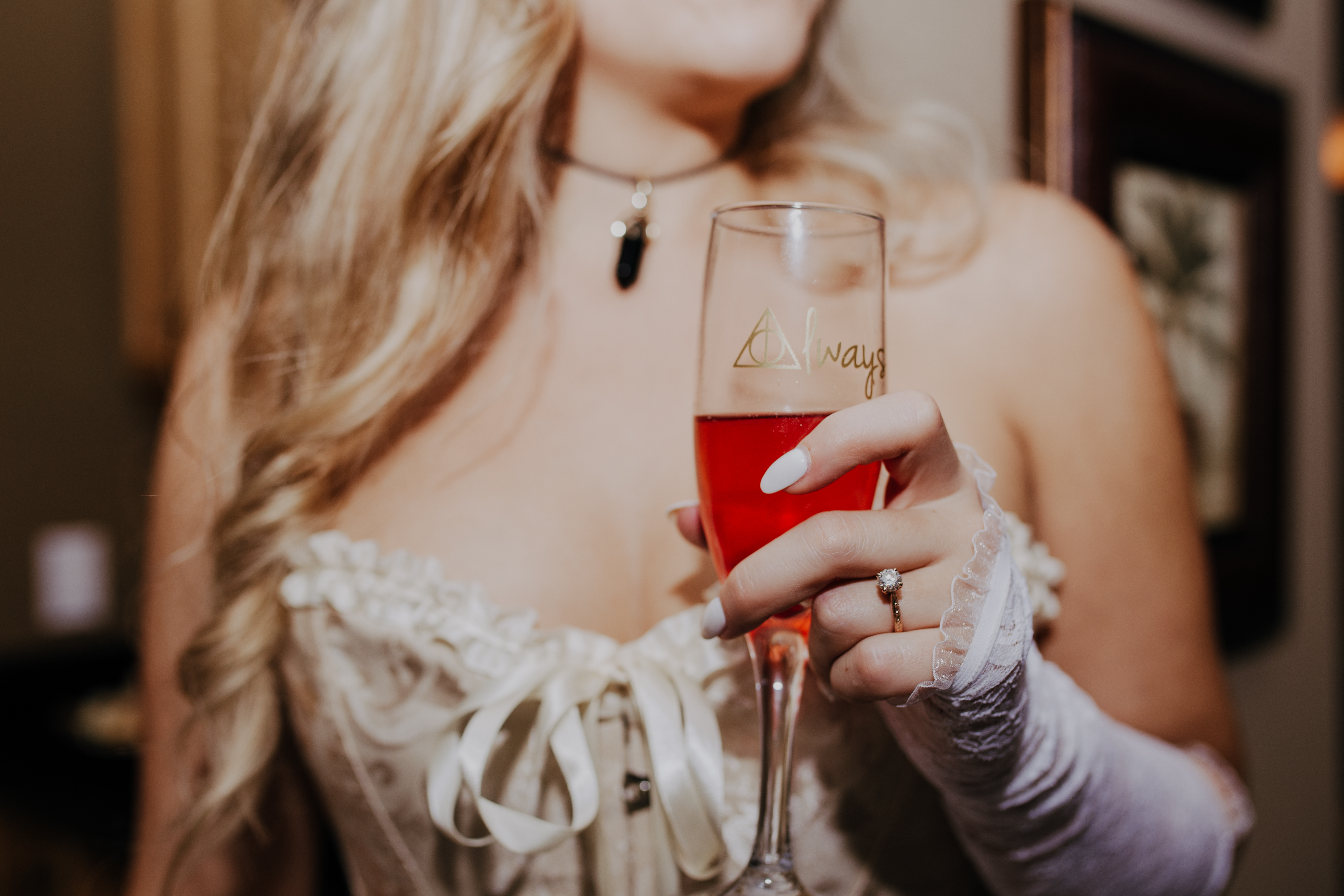 harry potter champagne glass held by bride with vintage rose gold ring that says always