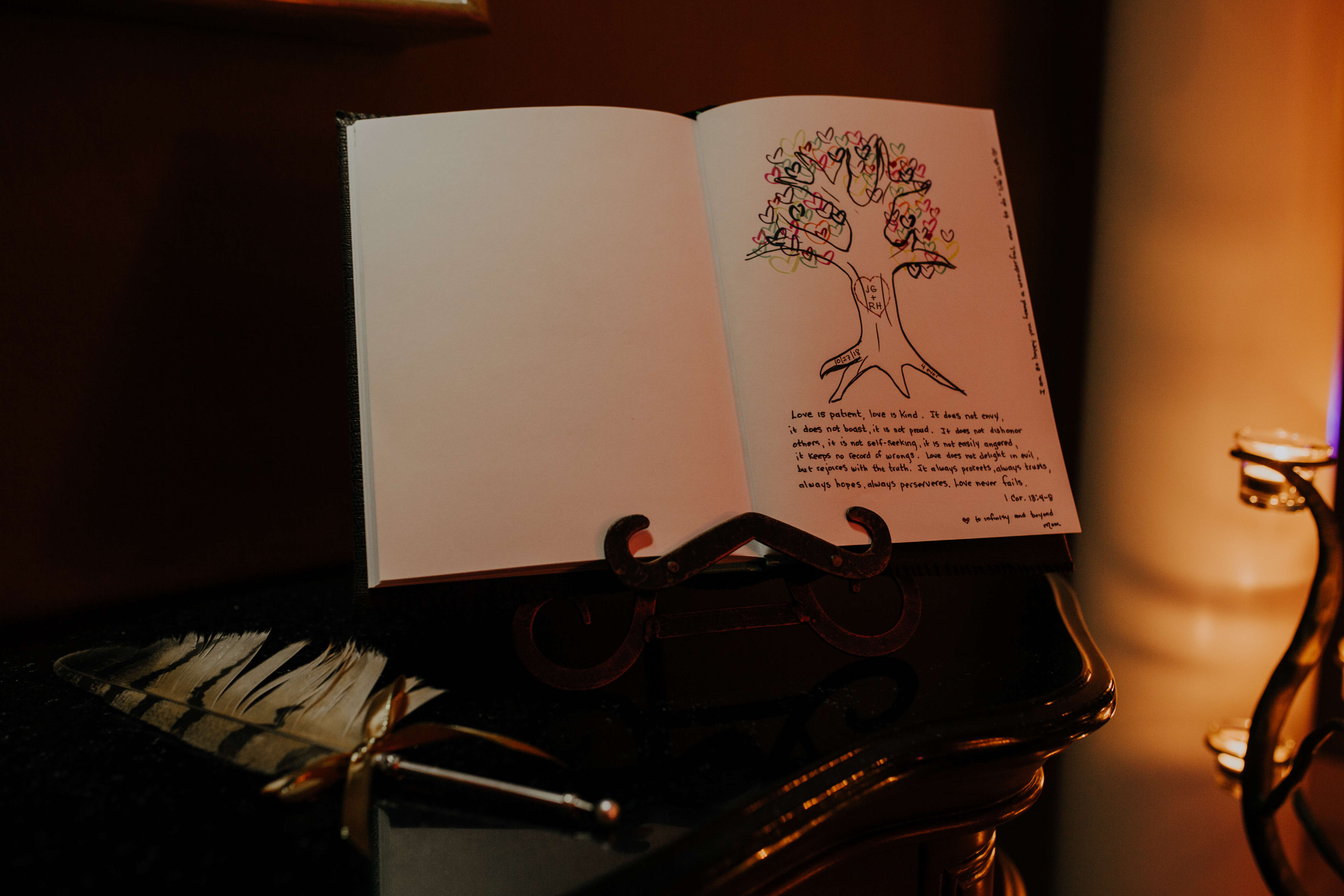 custom guest book with tree drawing and feather pen adds to the event