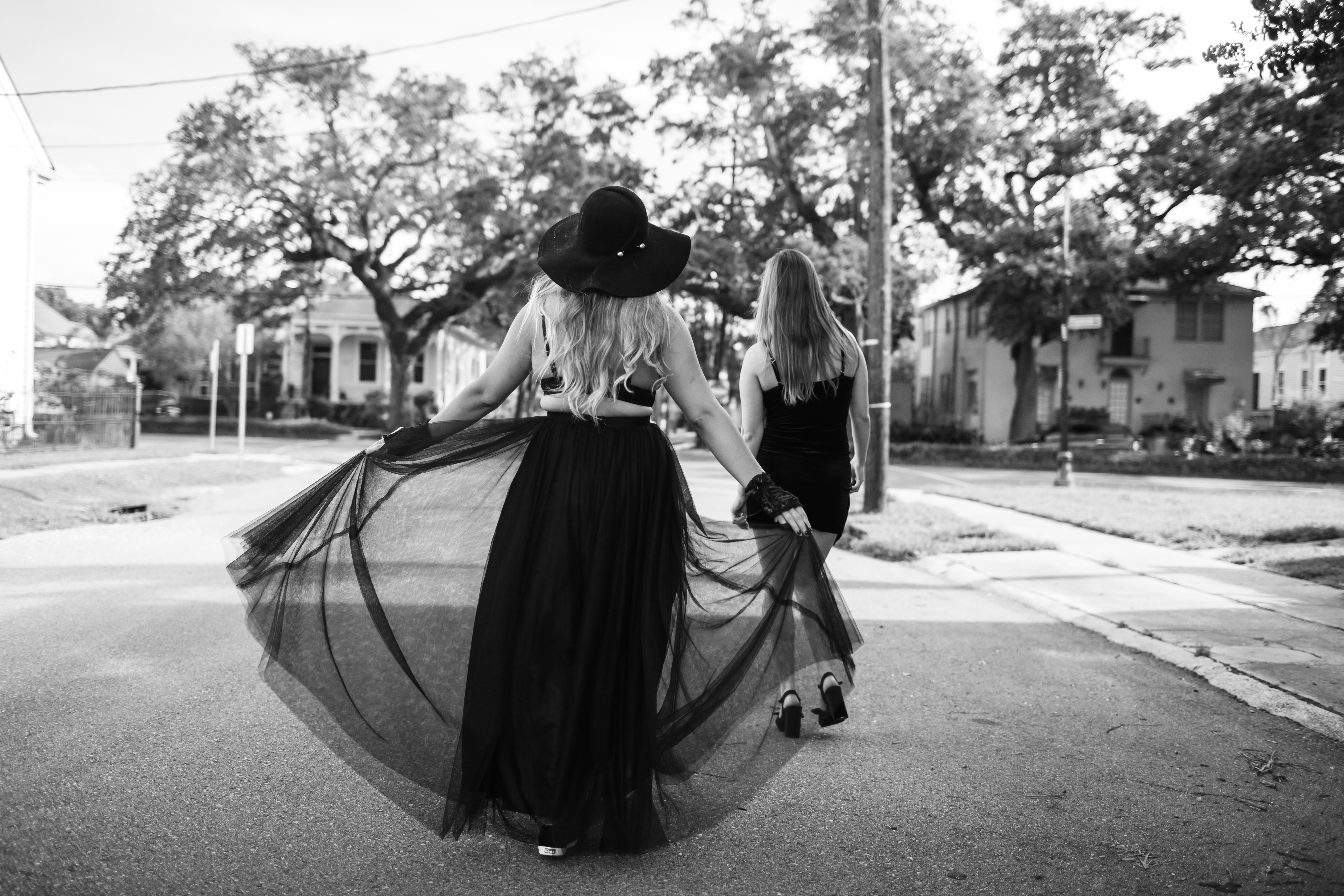 rachel looking like a good witch with her black skylar flowing in the streets of New Orleans.