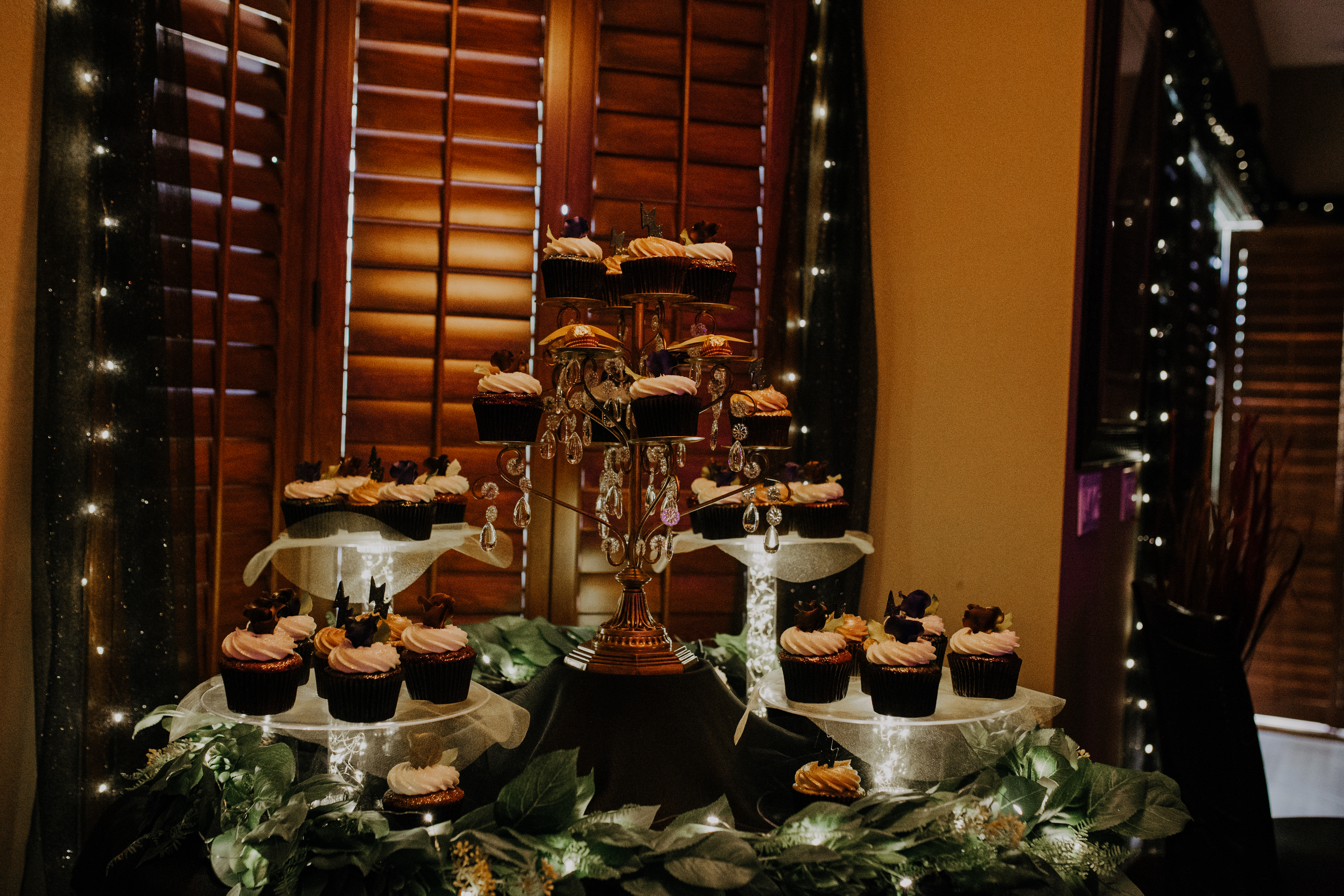 Stunning cupcake tower with fall harry potter treats and sweets table