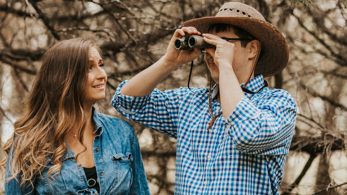 Rachel and Jon joking around looking into the future wilderness binocolours outdoorsy