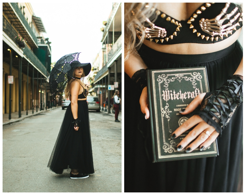 Girl in black tulle skirt and bones bra poses in the french quarter with parasol and holds a spellbook