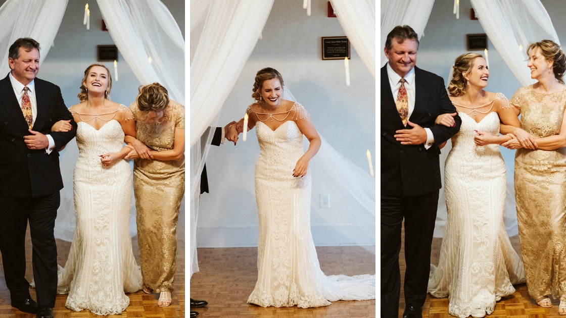Rachel Varina of Revelry Finally the bride walking down aisle and laughing with parents forgetting bouquet