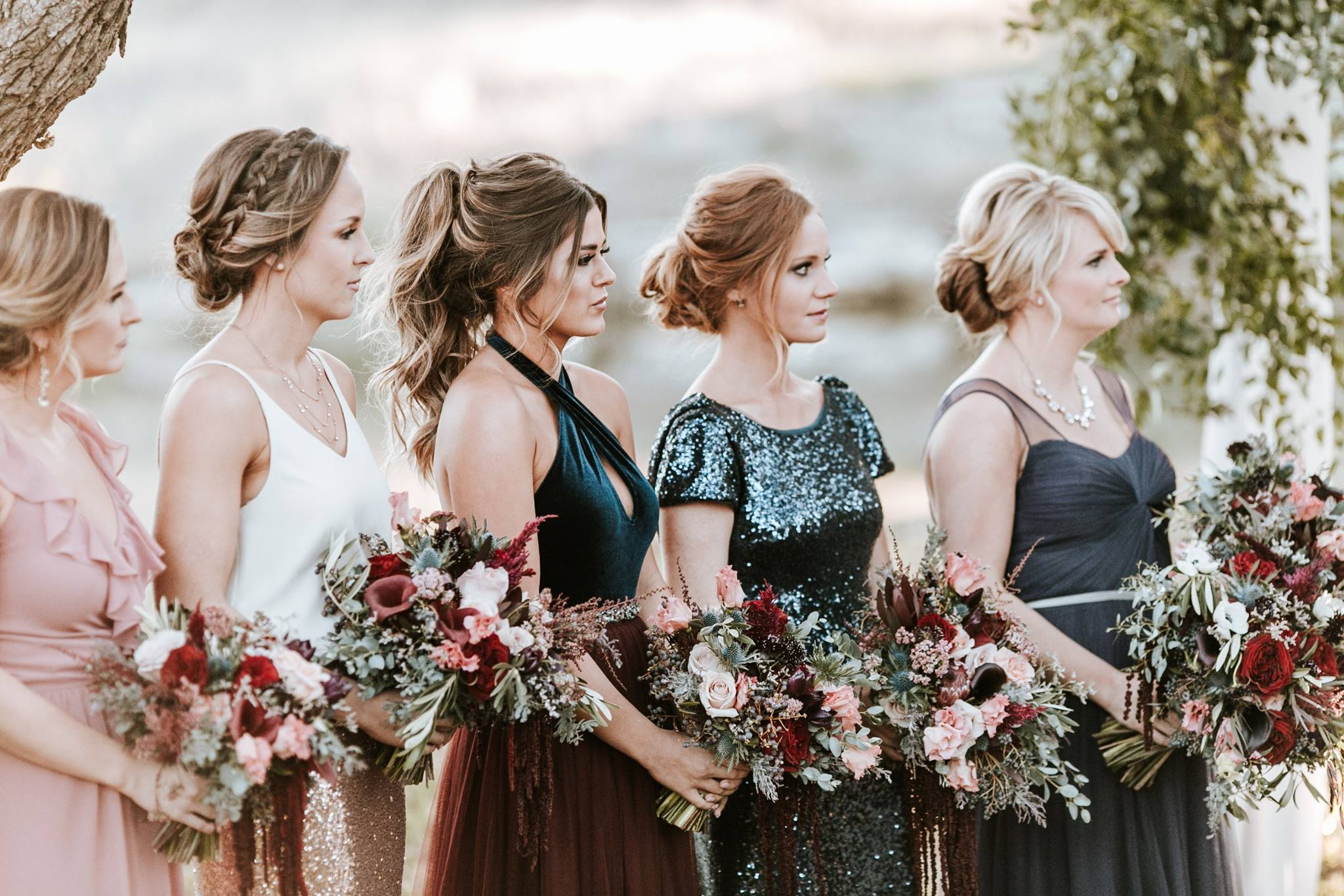 jojo fletcher and revelry bridesmaids standing next to bride during ceremony.