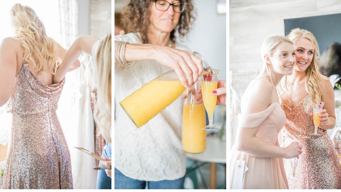 Revelry bridesmaid and bridal try onn party mom pouring orange juice and mimosas with strawberries blonde hazel bridesmaid dress brude in blush chiffon dresses smiling and posing