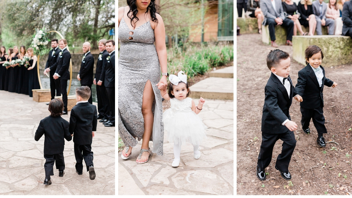 Ring walking down aisle in tux suits holding rings flower girls walking down aisle with white flower dress