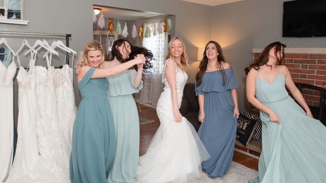 Sarah Aprino finally the bride wedding dress mona revelry bridal gown tulle white dress bridesmaids dancing blue and green mint chiffon dresses having fun at party