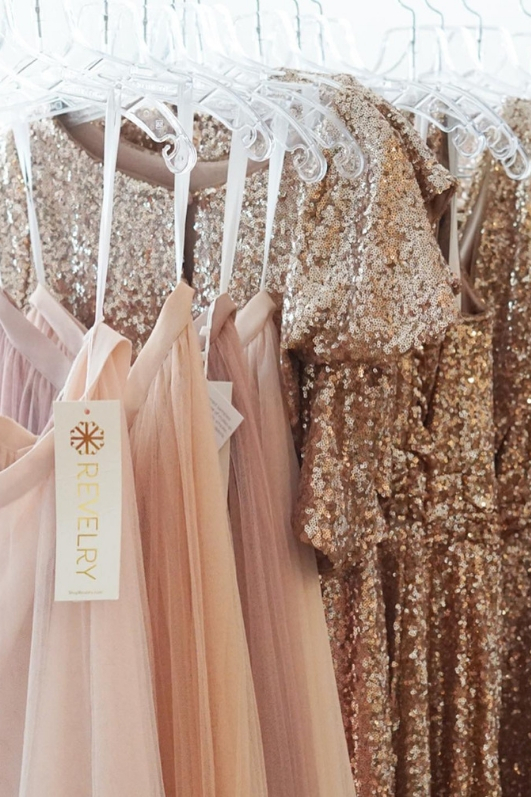 Rack shot of revelry bridesmaid styles pink and blush tulle skirts and sequin tops and sequin dresses