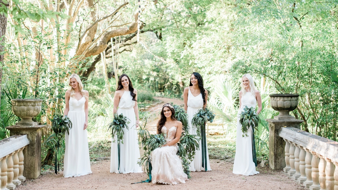 Spring Style Trends Revelry Wedding Bridesmaids in White Wedding Dress Rose Gold Greenery