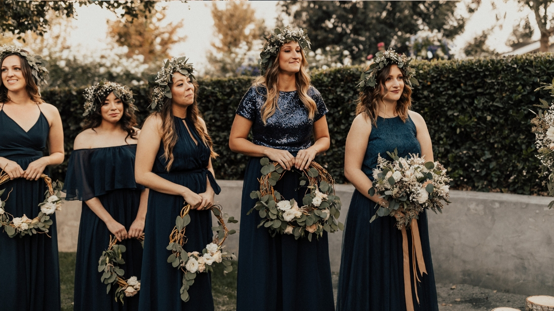 Spring Wedding Trends Revelry greenery flower crowns hoops blue dresses alter wedding day