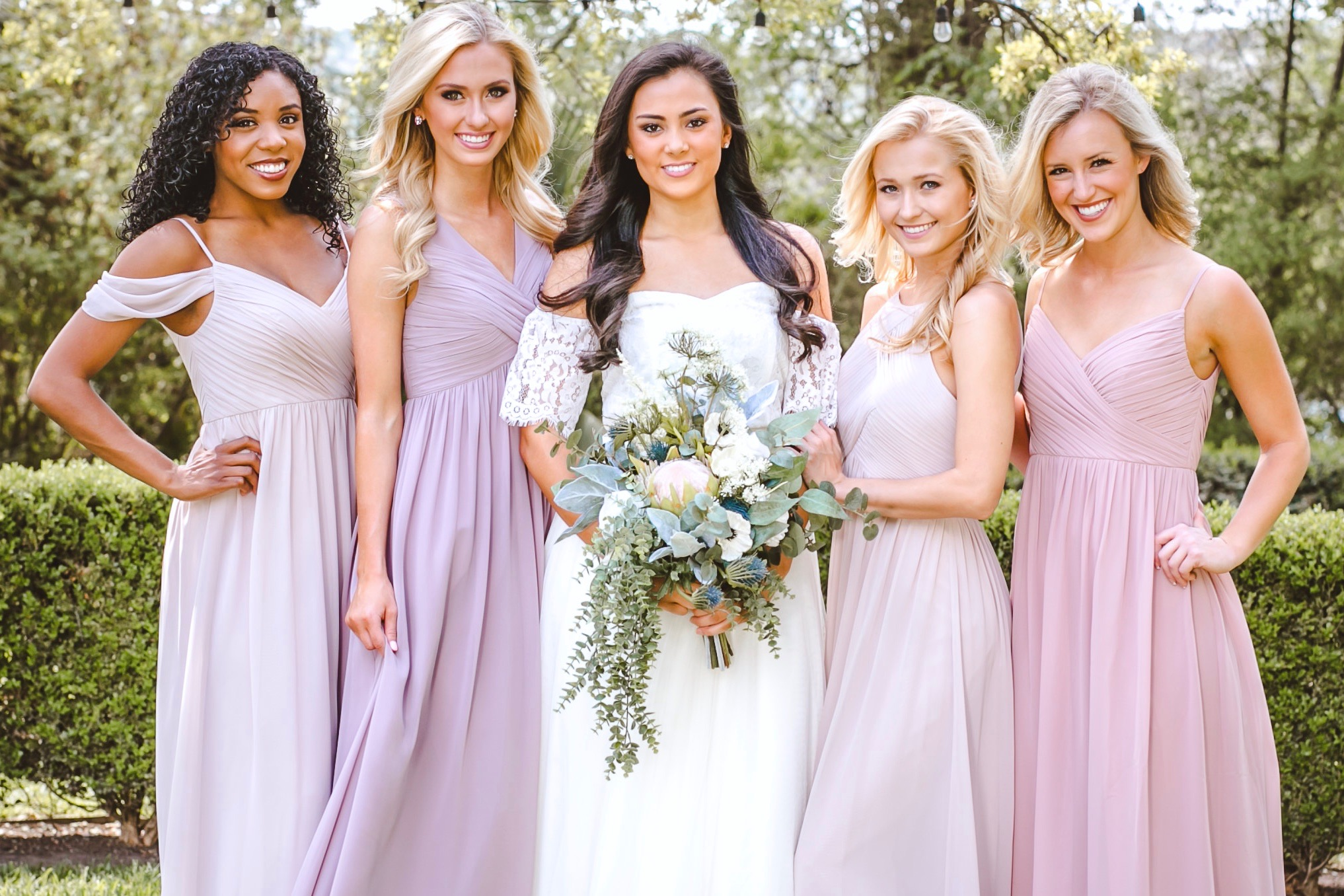 updated classics, and new spins on classic styles of Revelry bridesmaid dresses in mauve, blush, and neutral Chiffon.