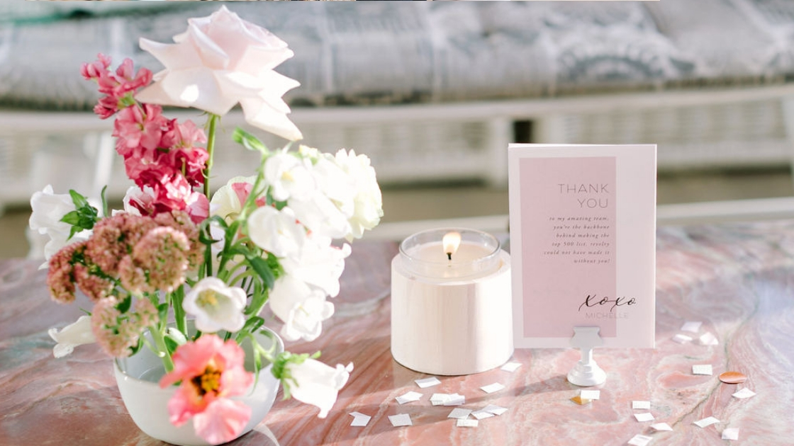 Table setting pink marble flowers pink white florals white candle thank you note to team mauve color note